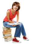 Lovely student with a lot of books stock image