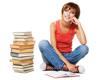 Lovely student with a stack of books royalty free stock image