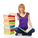 Lovely student with a stack of books Royalty Free Stock Photo
