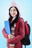 Lovely student in warm clothes carrying bag Stock Image