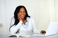 Lovely student woman smiling and looking to laptop Royalty Free Stock Images