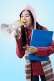 Lovely student yelling with a megaphone Royalty Free Stock Photo
