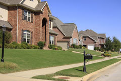 Lovely Subdivision of Upscale Homes. An upscale neighborhood of beautiful brick homes and landscaped yards Royalty Free Stock Photo