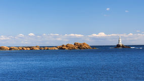 Lovely summer afternoon at the pier in town of Ahtopol with views of the lighthouse. Bulgaria. Stock Photography