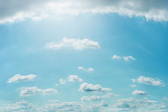 Lovely summer clouds on blue sky background in good weather with sunlight Royalty Free Stock Photo