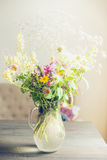 Lovely summer flowers Bouquet  on table in light living room. Home. Decoration and interior Royalty Free Stock Image