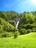 Beautiful sunny day with a water fall and a wonderful blue sky royalty free stock photo