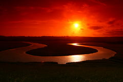 Lovely sunset. A beautiful sunset reflecting off a river below which forms a u shape below. Taken at Seven Sisters UK stock photo