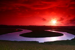 Lovely sunset. A beautiful sunset reflecting off some gorgeous clouds and a u shaped river winding its way to the sea near Seven Sisters UK stock images