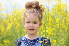Lovely sweet girl happy beautiful woman on blooming rapeseed field in spring Royalty Free Stock Image