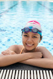 Lovely swimmer. Vertical portrait of a young female swimmer smiling and looking at camera Royalty Free Stock Photography