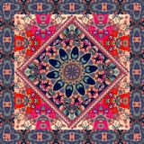 Lovely tablecloth with mandala and ornamental border on floral background. Ethnic square rug Royalty Free Stock Photography