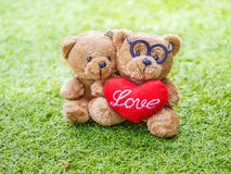 Lovely teddy brown bear and red heart shape Stock Photo