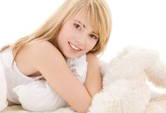 Lovely teenage girl. Bright picture of lovely teenage girl in bed royalty free stock image