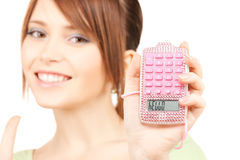 Lovely teenage girl with calculator Royalty Free Stock Photography