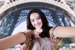 Lovely teenage girl at Eiffel Tower Royalty Free Stock Photo