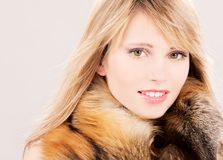 Lovely teenage girl in fur Stock Images