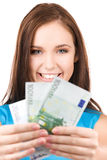 Lovely teenage girl with money Stock Photo