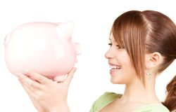 Lovely teenage girl with piggy bank Stock Photography