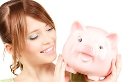 Lovely teenage girl with piggy bank Royalty Free Stock Images