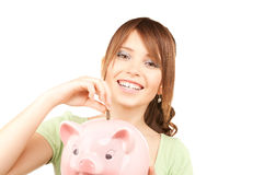 Lovely teenage girl with piggy bank and coin Royalty Free Stock Images