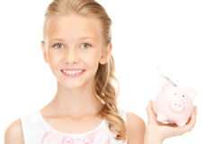 Lovely teenage girl with piggy bank and money Royalty Free Stock Images