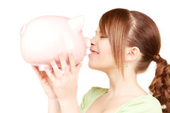 Lovely teenage girl with piggy bank Stock Photos