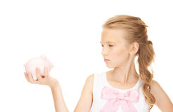 Lovely teenage girl with piggy bank Stock Image