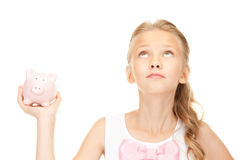 Lovely teenage girl with piggy bank. Picture of lovely teenage girl with piggy bank Stock Photos