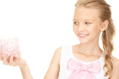 Lovely teenage girl with piggy bank. Picture of lovely teenage girl with piggy bank Royalty Free Stock Photo