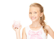 Lovely teenage girl with piggy bank. Picture of lovely teenage girl with piggy bank Royalty Free Stock Photos