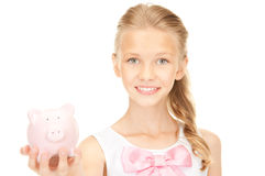 Lovely teenage girl with piggy bank Royalty Free Stock Photo