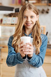 Lovely teenage girl posing with a cup of coffee Royalty Free Stock Image