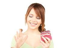 Lovely teenage girl with purse and money Stock Image