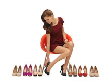 Lovely teenage girl in red dress with shoes Stock Photo