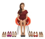 Lovely teenage girl in red dress with shoes Royalty Free Stock Images