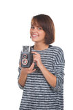 Lovely teenage girl with retro photo camera Stock Images