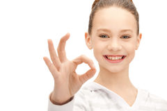 Lovely teenage girl showing ok sign. Bright picture of lovely teenage girl showing ok sign Royalty Free Stock Photo