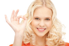 Lovely teenage girl showing ok sign Stock Photos