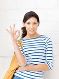 Lovely teenage girl showing ok sign. Bright picture of lovely teenage girl showing ok sign Stock Photo