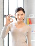 Lovely teenage girl showing ok sign. Bright picture of lovely teenage girl showing ok sign Royalty Free Stock Photos