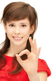 Lovely teenage girl showing ok sign Royalty Free Stock Photos