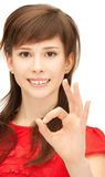 Lovely teenage girl showing ok sign Stock Image
