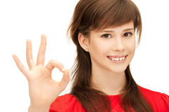Lovely teenage girl showing ok sign Royalty Free Stock Image