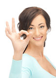 Lovely teenage girl showing ok sign Stock Image