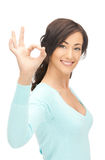 Lovely teenage girl showing ok sign Royalty Free Stock Images