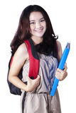 Lovely teenage student with backpack in studio Royalty Free Stock Photos