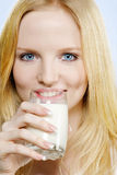 Lovely teenager girl drinking milk Royalty Free Stock Photography