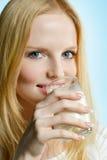 Lovely teenager girl drinking milk Royalty Free Stock Photos