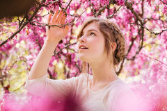 Lovely tender young woman in spring garden with blooming trees Stock Image